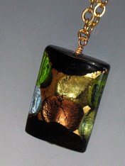 This magnificent rectangle pendant features topaz and peridot dots.  Very special and limited.