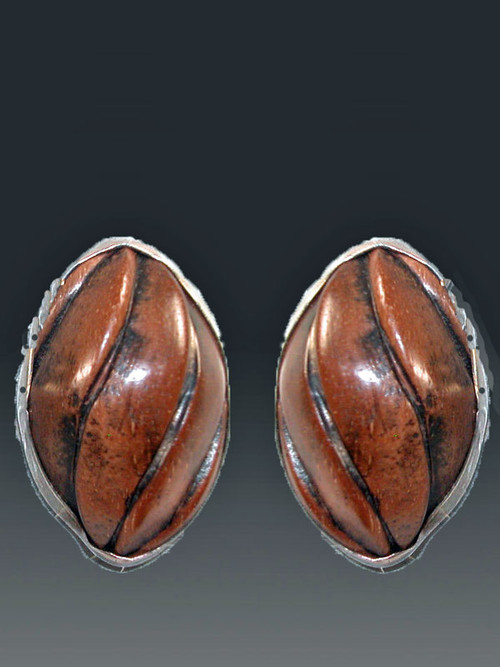 Ever wish you had elegant carved wood earrings to go with your casual tribal looks?  If the answer is yes,you'll love these gorgeous earrings. These Amy Kahn Russell earrings feature richly grained hand carved wood bezel set in a sterling silver frame.   1-1/4 ovals. Now clips; convert to posts for $15.