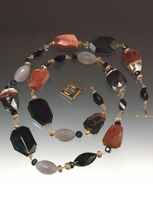 A striking collage of shapes and colors! Faceted multi-agate slices artfully mixed with grey and black onyx, cognac Swarovski crystals, raw garnet, hand-wire non-tarnish gold/copper wire. Wear alone or pair with others in the collection. 34""