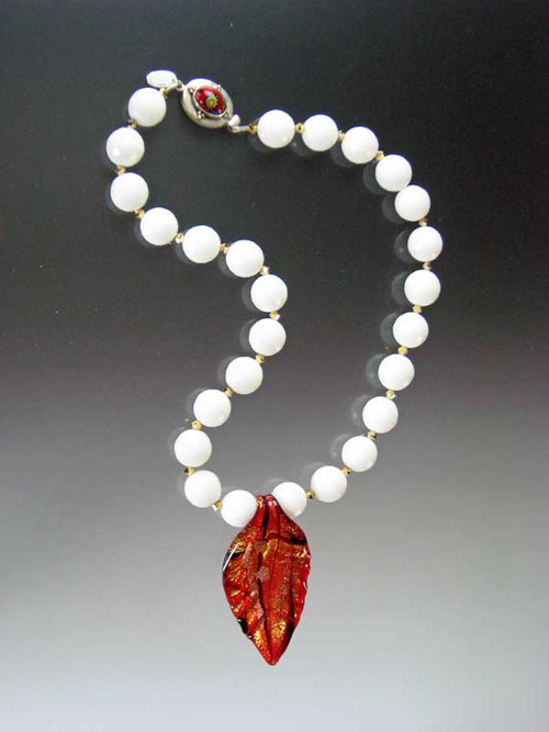 """A website best buy! This collar features faceted white agate beads, 24K plated Swarovski crystal, a limited edition handmade Venetian glass leaf over gold foil and aventurina copper.A Venetian glass sterling clasp completes the picture. 19"""" Leaf 3""""x1-1/2"""""""