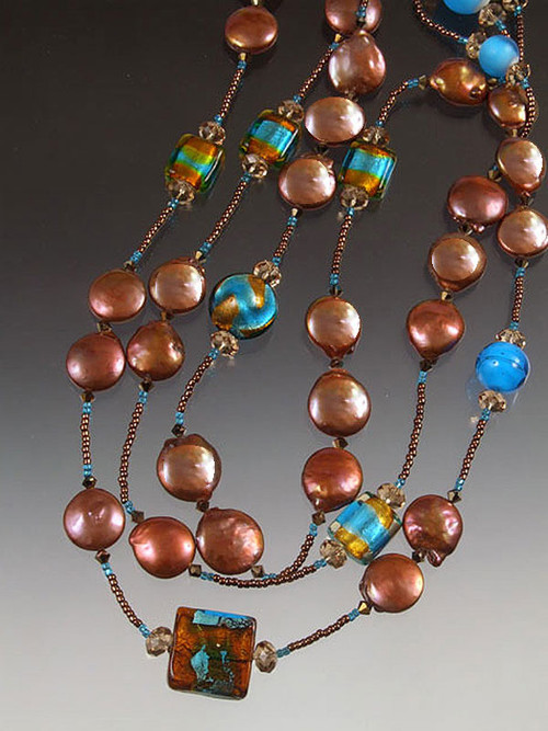 "Dramatic colors for the drama queen in you! This opulent rope features HUGE 17mm bronze coin pearls spaced with 24K topaz/aqua Venetian glass, Swarovski crystals and 14K gold clasp!  Available in 44"" or 64"""