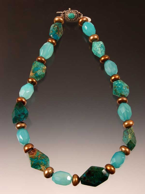 An intense showstopper to circle your neck and brighten any day.  Freeform chrysocolla faceted nuggets, luminous aqua calcedony faceted barrels, golden bronze freshwater pearl wheels with a dramatic center stone (no two alike). Chrysocolla or turquoise sterling clasp 18""
