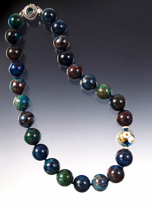 """Chrysocolla is often mistaken for turquoise because it flashes tones of sky blue, deep azure, green, brown and copper, a variety of vibrant tones highly sought by collectors. This gorgeous strand of perfect 16mm round stones is Japanese double hand-knotted with blue silk and features a 24K transparent Zanfirico Venetian glass aqua highlight framed with 14K rondels. The clasp is faceted aquamarine and sterling silver. 18"""""""