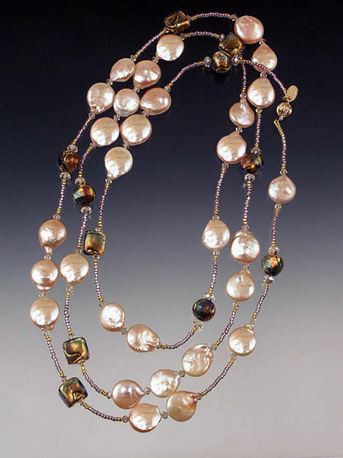 """A website bestseller, this opulent rope features lustrous 16mm natural Grade AAA pink coin pearls. 24K amethyst-periwinkle Venetian glass, Ceylon Swarovski crystals and a 14K gold clasp. Stunning as a long rope or tripled around the neck! Available in 42"""" or 62"""""""