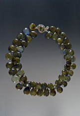Enjoy this dimensional glittering collar of briliant labradorite teardrop florets shooting off sparks of blue, gray, green and other tones to pick up what you're wearing with a gorgeous custom labradorite sterling clasp.  19""