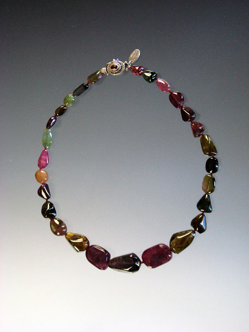A striking strand of silk-knotted watermelon tourmaline nuggets.