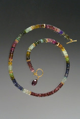 This elegant necklace features precious gemstones spaced with 14k fluted rondels.