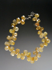 "Go for the gold in this fabulous 19"" Brazilian rutilated quartz faceted teardrop collar."