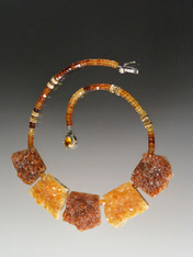 This opulent collar  features five huge natural slices of Brazilian citrine druzy in shades of rich auburn and gold and multi-toned hesssionite garnet rondels.