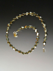 "A simple but dramatic and sparkling 18"" collar of natural silver pyrite with Swarovski crystals."