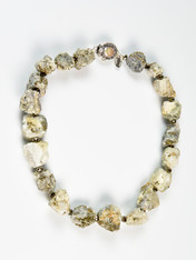 """Like the """"fool's gold"""" that tricked gold rush miners, these raw nuggets glisten with sparkling gold and silver flashes are spaced with Swarovski crystals."""