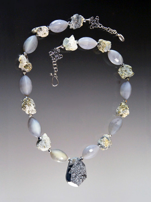 A gorgeous adjustable necklace of  raw pyrite,gray agate, and a Brazilian titanium pyrite druzy silver pendant.