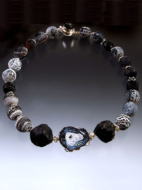 A dramatic collar of weathered agate balls with hammered tourmaline, two large Brazilian hammered onyx stones and a freeform weathered agate slice.