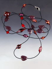 """This vibrant rope of raw ruby slices, 24K ruby/garnet Venetian glass  lets you double or triple with ease. Choose 42"""" or 64""""."""
