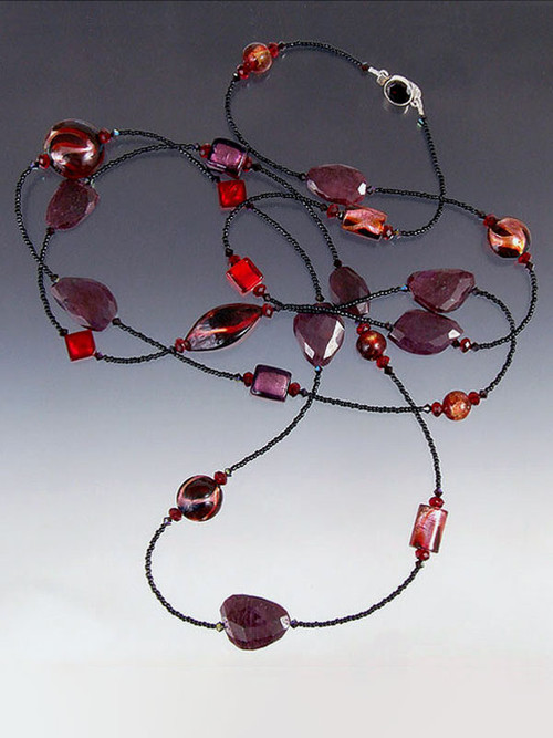 "This vibrant rope of raw ruby slices, 24K ruby/garnet Venetian glass  lets you double or triple with ease. Choose 42"" or 64""."