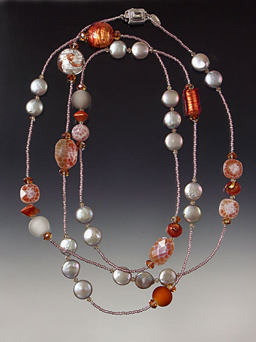 This stunning rope features silver coin pearls, richly patterned fire agate, Venetian glass discs and frosted balls, and ceramic hexagons.