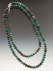 "This versatile 39"" rope features natural turquoise rondels spaced with Czech glass."