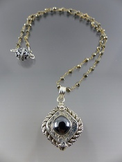 Hematite Ornate Poison Silver Locket on Wire Wrapped Pyrite Chain