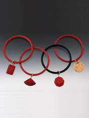 Bangles go with baubles.  So choose one of these hand-carved cinnabar bangles in red or black with a cinnabar hand-carved fan, octagon, flowered box, or jade (no two exactly alike).  They also make great gifts and fit all wrists.