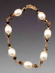 """A delicate hand-wrapped gold wire bracelet of white freshwater pearls and Swarovski crystals, 24K vermeil clasp. Available in 7"""", 7-1/2"""", or 8""""Matching necklace, rope, and earrings available."""