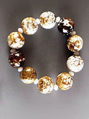 Faceted multi-jasper balls in tones of white, bronze, gold and brown with Alabaster Swarovski crystals.  Stretches to 8""
