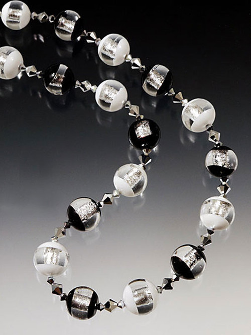 """These lighter than air Venetian glass beads blend opaque white and black with a transparent """"window"""" featuring bands of pure sterling silver. Each color spaced with rare sterling coated Swarovski crystals. 19"""""""