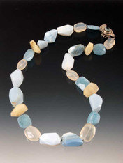 This delightful collage of Grade AAA Oregon and Peruvian opal, calcedony, and faceted aquamarine features a vintage Peruvian aquamarine sterling clasp.  19""