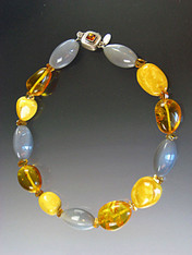About 20 years ago I found a strand of huge precious baltic amber beads and now I've used them in this magnificent collar mixed with grey hexagon shaped moonstones and grade AAA faceted citrine.  This beautiful necklace features a vintage amber sterling clasp with safety hinge. 19-1/2""