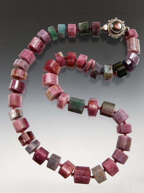 SO RARE AND SO FABULOUS! This strand of grade AAA trillion cut Brazilian strawberry tourmaline features amazing colors, Japanese double hand-knots in silk and a custom mabe pearl sterling  clasp. 18""