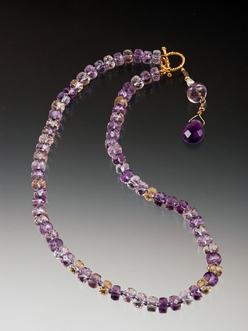 This elegant necklace features glittering faceted ametrine rondels held with a 14K cast toggle clasp with lilac amethyst faceted teardrop dangle