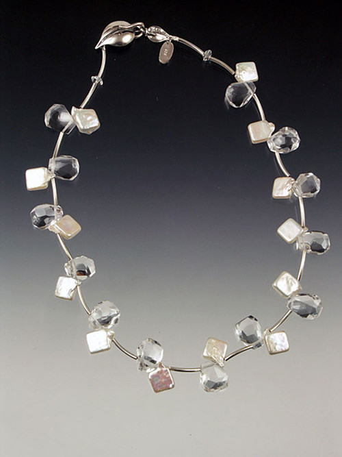 "Light as a feather and so versatile! A cool collar of rock crystal and luminous white pearls spaced with sterling vines and held with a large sterling leaf clasp to be worn side, center or back. 17"" Also available in 18"" and 19"""