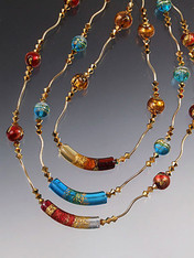 "The perfect holiday gift to wear all year long! Circle your neck with 17"" of  glittering gold -- sparkling 24K Venetian glass framed with 24K gold-plated Swarovski crystals and 14K tubes and toggle. Light as a feather and totally dazzling!   Choose cobalt/peridot, aqua/gold, garnet/gold, topaz/gold."