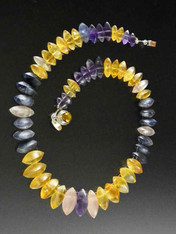 """If you like subtle luxury and something you won't see on anyone else, this is for you. This wonderful collar features dimensional grade AAA matte finish iolite, amethyst and citrine  with two sets of holes that make it fit like a Grecian collar. This one is 17"""" and features an amber sterling clasp."""
