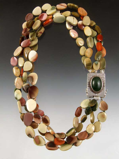 "This magnificent torsade of Imperial Jasper( the finest in the world- found only in Australia) is hand-knotted with pale green silk (20-21"").  A limited edition jade, copper, sterling clasp (1""x1-1/2"") can be worn as a center or side highlight. You will be amazed at how many shades this matches.  An all time bestseller...cannot be reordered."