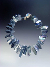 """A website best buy with amazing impact! An 18"""" collar of iridescent natural quartz with tones of silver and pale blue with custom sterling clasp. Also available in 19.5"""""""