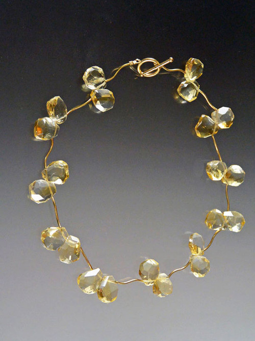 A bestseller from the time it was launched. This fabulous necklace features extra large Grade AAA citrine blossoms set between 14K branches and toggle. 17-1/2 ""