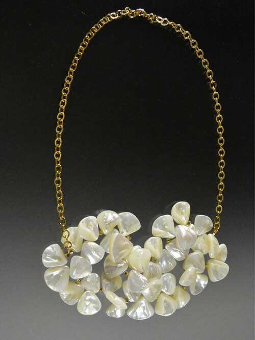 """This versatile design features huge sparkling mother of pearl fan shapes spaced with 24K Swarovski crystals clustered in the center of a 24K ultraplate chain that goes from a 17"""" collar to a  to bib.  Your choice."""
