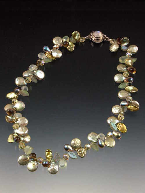 A delicate and dazzling collar of sage coin pearls, petal pearls, precious stones, tourmalated quartz, frosted glass leaves, and Swarovski crystals, with custom moonstone sterling clasp. Each made completely by hand so no two are identical. 17-1/2""