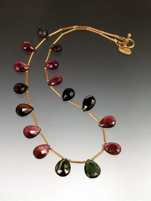 This luxurious collar features Grade AAA faceted tourmaline teardrops from deep green to strawberry to pale cognac with18Kstations andtoggle clasp. (Note: Contact us for availablity of less karat weight at a lower price)