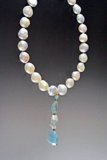 "This magnificent showstopper features HUGE Grade AAA opulent 16mm white puffy coin pearls, a 14K toggle clasp and an amazing dangle with three different Grade AAA faceted Brazilian aquamarine stones (54 grams) . Necklace 19""  Dangle 3-1/2"""