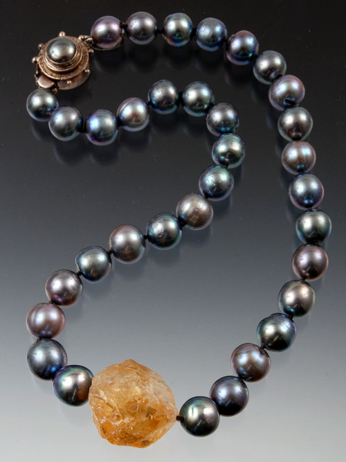 """Totally spectacular!! Huge 16mm natural gray/mauve south sea pearls frame a rich golden orange Brazilian hammered citrine center.Hand-knotted with double Japanese-stylesilkknots. Custom mabe pearlsterling clasp.18"""""""