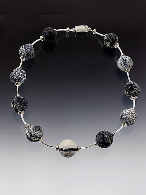 """Circle your neck with a whimsical collar featuring weathered* black and white agate balls, each totally unique in its natural formation, spaced with sterling silver saucer and curved tube beads and a curved sterling clasp. Perfect for every season and every occasion.  19"""" (available longer or shorter)"""