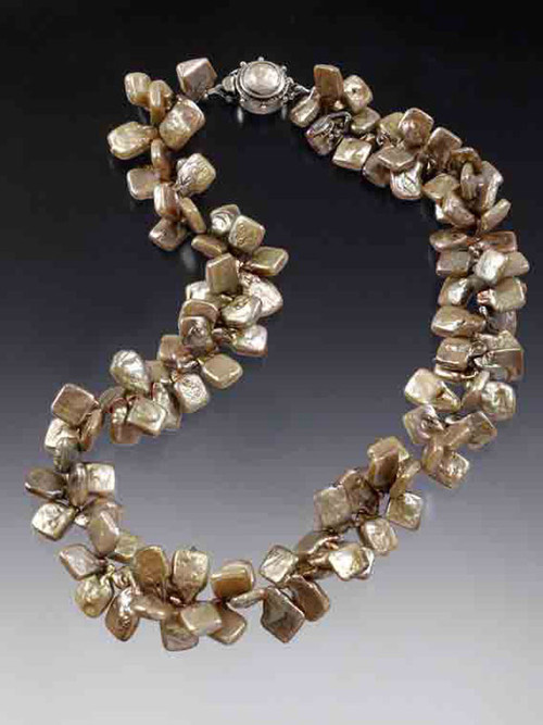 """These unusual and highly dimensional (suggesting a double strand) square champagne pearls have fabulous lustre and can go from day to night without missing a beat. A beautiful custom mabe pearl sterling clasp completes the picture. Limited. 18"""""""