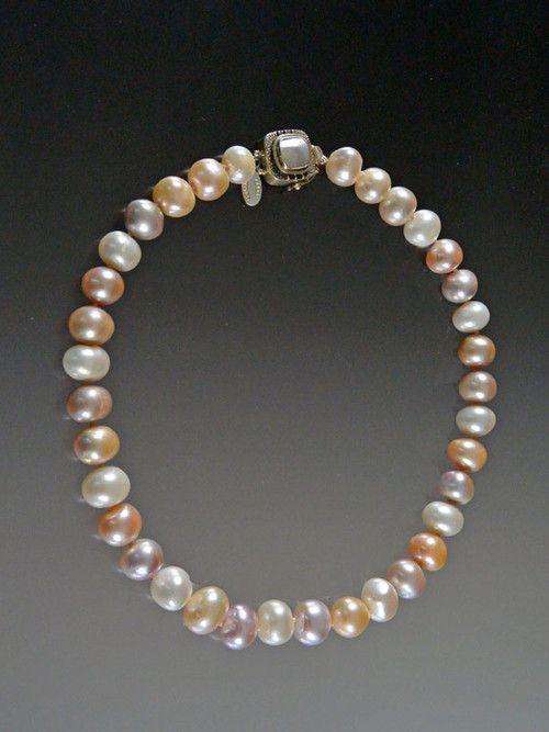"""Classic pearls with a twist. Not perfectly round. Not perfectly white. Just perfectly baroque with enough cool to take the place of the strand you reach for to wear with everything. Double Japanese silk knots and a custom pearl sterling clasp. 17"""""""