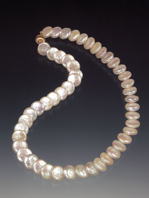 New Twist on the Classic String of Pearls!... High-luster perfectly matched white coin pearls with a 14K ball clasp that can be worn as a side or center highlight.  17""