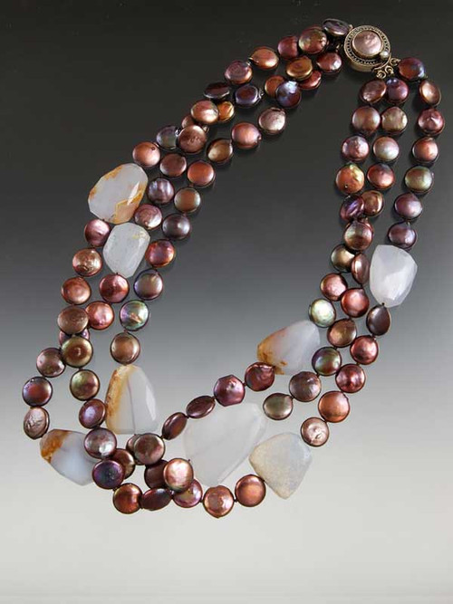A bold statement for any occasion -- large facetednatural raw chalcedony slices float on a sea of brown coin pearl strands with a Peruvian mabe pearl custom clasp that can be a side or center station.  20""