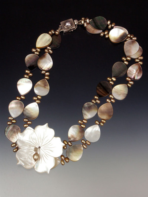 """A website bestseller! This creamy mocha mother-of-pearl and champagne freshwater pearl collar features a 2"""" x 2"""" carved whitemother-of pearl flower. Whether fair or dark, you'll be amazed at how it flatters your complexion and complements your wardrobe in every season. 20"""""""