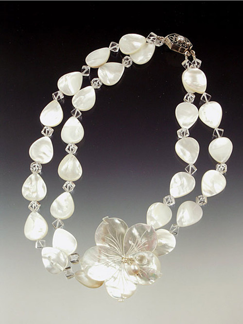 Brilliant white mother of pearl leaves and flowers with crystal  highlights. 19""