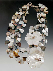 """An incredibly dramatic statement piece! Nesting strands of black, white and brown mother of pearl fans with flashes of mocha complemented by two hand carved nesting mother of pearl flowers. Fit for the fanciest occasion or just for fun! 19"""""""