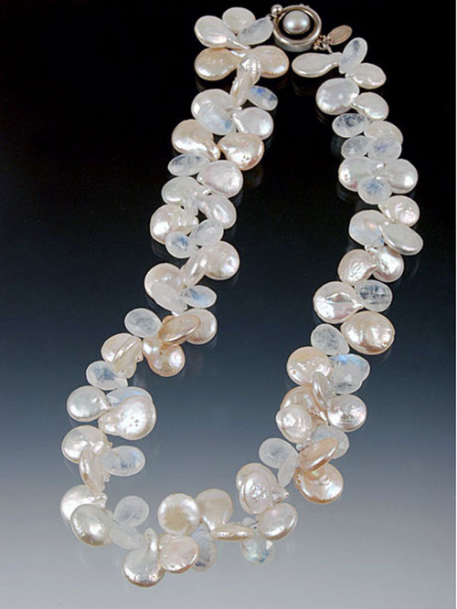 "When you use the word ""showstopper"" this is it!  Absolutely HUGE 17mm grade AAA white coin pearls randomly spaced with gorgeous rainbow moonstone faceted teardrops.  The effect is like pearls and white diamonds.  17"""